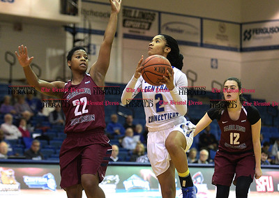 1/14/2017 Mike Orazzi | Staff CCSU's Taylor Goode (2) ) and Fairleigh Dickinson's Kiana Brown and Rainey Cox (12) Saturday in New Britain.
