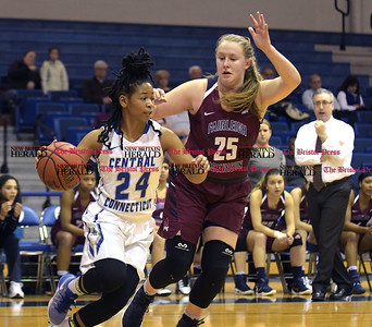 1/14/2017 Mike Orazzi | Staff CCSU's Aleah Epps (24) and Fairleigh Dickinson's Courtney Blankenship (25) Saturday in New Britain.