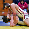 011817  Wesley Bunnell   Staff<br /> <br /> Newington High School wrestling vs New Britain on Jan 18 at Newington High School.  Newington's Wyatt Bernard, left, and New Britain's Marquise Haythe in the 220lb match.
