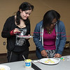 011817  Wesley Bunnell | Staff<br /> <br /> The New Britain Public Library held a STEAM event with students decorating emoji cookies on Wednesday afternoon. Anna Wolf, left, stands with Donna-Lou Douglas as they compare decorations.