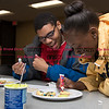 011817  Wesley Bunnell | Staff<br /> <br /> The New Britain Public Library held a STEAM event with students decorating emoji cookies on Wednesday afternoon. Raekwon Blocker , left, laughs as Emily Phillips puts the finishing touches on her cookie.