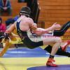 011817  Wesley Bunnell   Staff<br /> <br /> Newington High School wrestling vs New Britain on Jan 18 at Newington High School. New Britain's Kevin Carrasquilk , left, and Newington's Matt Buslewicz in the 145lb match.