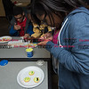 011817  Wesley Bunnell | Staff<br /> <br /> The New Britain Public Library held a STEAM event with students decorating emoji cookies on Wednesday afternoon. Donna-Lou Douglas snaps a photos of her decorated cookies.