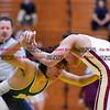 011817  Wesley Bunnell   Staff<br /> <br /> Newington High School wrestling vs New Britain on Jan 18 at Newington High School. Newington's Emilio Cruz , left, and New Britain's Joseph Padilla in the 113lb match.