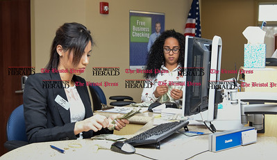 011917  Wesley Bunnell | Staff  Farmington Bank in Plainville which features an open layout between tellers and customers.  Personal Bankers Chantelle E. Villanueva, left, along with Crystal Hernanez at their stations.