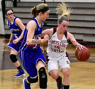 1/19/2017 Mike Orazzi | Staff Bristol Eastern's Hannah Maghini (11) and Bristol Central's Meghan Hamel (15) during Thursday night's girls basketball game at BC.