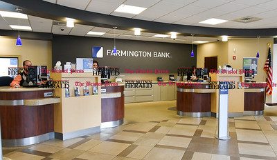 011917  Wesley Bunnell | Staff  Farmington Bank in Plainville which features an open layout between tellers and customers.  Personal Banker Kelvin J. Vazquez , left, with Assistant Vice President & Branch Manager Solidea Pitruzzello and Personal Banker Chantelle E. Villanueva.