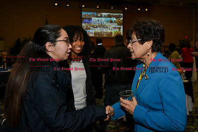 011917  Wesley Bunnell | Staff  A reception was held on Thursday afternoon in CCSU's Student Center for incoming President Dr. Zulma R. Toro. Junior Clarissa Torres, left, along with Sophomore Naelah Miller, center, introduce themselves to President Toro.