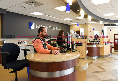 011917  Wesley Bunnell | Staff  Farmington Bank in Plainville which features an open layout between tellers and customers.  Personal Banker Kelvin J. Vazquez , left, with Assistant Vice President & Branch Manager Solidea Pitruzzello.