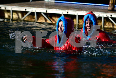 1/21/2017 Mike Orazzi | Staff Marilyn Cheyne and Mayra Roman during the 12th Annual YMCA Sloper Plunge held at  YMCA Camp Sloper in Southington Saturday. The event raises money for camp scholarships.
