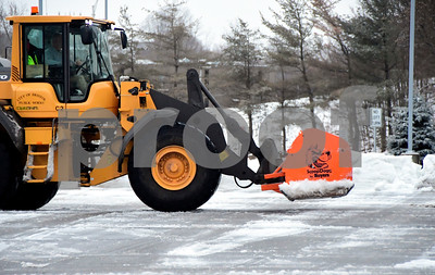 1/24/2017 Mike Orazzi | Staff Bristol Public Works employee clears snow in Centre Square in Bristol Tuesday morning after an over night storm.