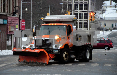 1/24/2017 Mike Orazzi | Staff A state plow clears snow at the intersection Main Street and Riverside Avenue in Bristol Tuesday morning after an over night storm.