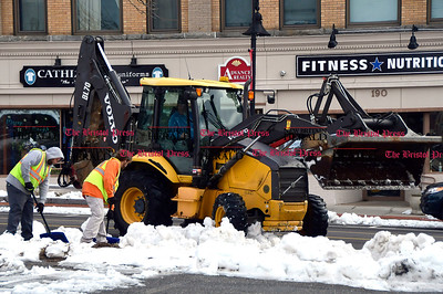 1/25/2017 Mike Orazzi | Staff Bristol Pubic Works employees remove snow from Main Street while cleaning up from Tuesday's storm.