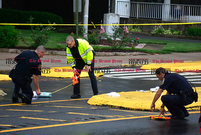 7/7/2016 Mike Orazzi | Staff Bristol Police while investigating after an 80 year old male was struck by a vehicle on North Main Street Thursday afternoon.