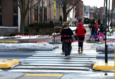 1/26/2017 Mike Orazzi | Staff Pedestrians cross North Main Street using the crosswalk in Bristol Thursday.