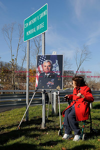 11/19/2011 Mike Orazzi | Staff Ninety nine year old Francis Coluccia looks at a photograph of her nephew CSM Anthony Savino during a ceremony naming the Pequabuck River bridge on the Route 72 extension on Saturday morning. Coluccia will be 100 in January.  ** for a Steve story **