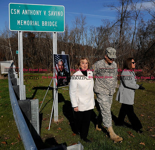 11/19/2011 Mike Orazzi | Staff CSM Anthony V. Savino's wife Deanna Savino with her children Anthony Jr. and Cathy during a ceremony naming the Pequabuck River bridge on the Route 72 extension on Saturday morning.  ** for a Steve story **
