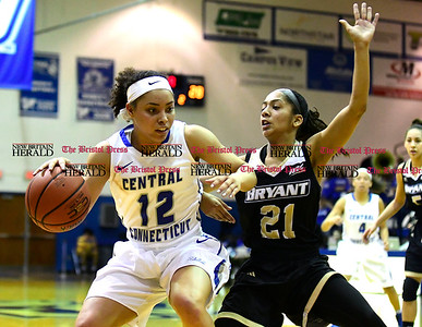 1/28/2017 Mike Orazzi | Staff CCSU's Sydney Hines (12) and Bryant's Chanel Ramcharran (21) during Saturday's basketball game in New Britain.