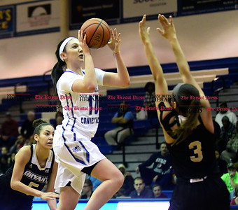 1/28/2017 Mike Orazzi | Staff CCSU's Andi Lydon (10) and Bryant's Sydney Holloway (3) during Saturday's basketball game in New Britain.