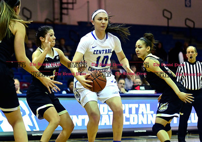 1/28/2017 Mike Orazzi | Staff CCSU's Andi Lydon (10) and Bryant's Masey Zegarowski (1) and Naomi Ashely (5) during Saturday's basketball game in New Britain.
