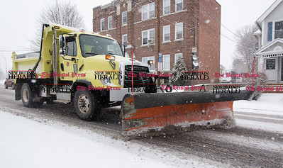 013117 Wesley Bunnell | Staff  A snow plow clears Arch St. on Tuesday afternoon.