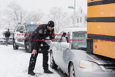 013117 Wesley Bunnell | Staff  An accident involving a Honda Civic and a school bus occurred at the intersection of Arch and Monroe St on Tuesday afternoon.  Ofc. Wichowski speaks with the driver of the Civic.