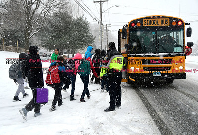 1/31/2017 Mike Orazzi | Staff Some of the students riding a bus that slide into a utility police at the intersection of Willis and Buckingham Streets are transferred to another bus on South Street during Tuesday's snow storm.