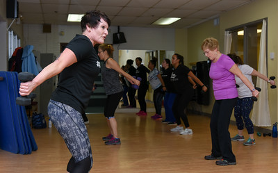 010316  Wesley Bunnell | Staff  The YWCA held a group exercise class Rock Your Resolution on Tuesday evening consisting of a 90 minute training circuit. Instructor Michele DeRosier, shown left, leads the class in weight training including Jeanette Fresina, shown right.
