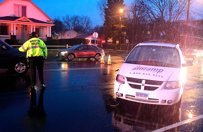 1/3/2017 Mike Orazzi | Staff Bristol police while directing traffic on Pine Street at the intersection of Poplar Street in Bristol after a three-car crash Tuesday during rush hour.