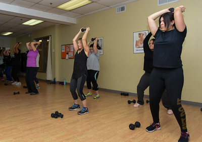 010316  Wesley Bunnell | Staff  The YWCA held a group exercise class Rock Your Resolution on Tuesday evening consisting of a 90 minute training circuit. Members in a weight training class are from left, Jeanette Fresina, Evelyn Jacobs, middle, Zionjane Ortiz, back row right, and Amanda Avenaut.