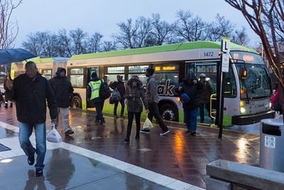 010316  Wesley Bunnell | Staff  Riders at the Downtown New Britain CTfastrak exit their bus into the rain the rain on a cold and rainy Tuesday afternoon.