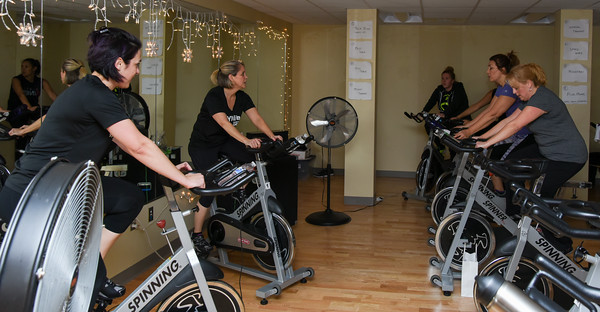 010316  Wesley Bunnell | Staff  The YWCA held a group exercise class Rock Your Resolution on Tuesday evening consisting of a 90 minute training circuit.  Community Wellness Director Valerie Rodino, shown left, helps instruct the spin class along with instructor Beth Cianchetti , shown in the middle.