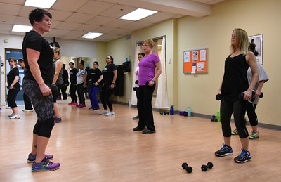 010316  Wesley Bunnell | Staff  The YWCA held a group exercise class Rock Your Resolution on Tuesday evening consisting of a 90 minute training circuit. Instructor Michele DeRosier, shown left, leads the class in weight training including Jeanette Fresina, shown middle and Evelyn Jacobs on the right.
