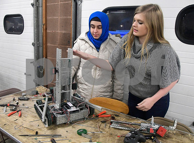 1/4/2017 Mike Orazzi | Staff Southington Cyber Knights robotics team members Betul Agirman and Mary Bilodeau work on a VEX robot at their new location on West Street in Southington.