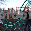 010416  Wesley Bunnell | Staff<br /> <br /> A mild afternoon brought Amanda Capo and her twins Logan and Sofia to Walnut Hill Park's playground on Wednesday.  Amanda helps Logan across an obstacle course as Sofia waits her turn.