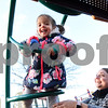 010416  Wesley Bunnell | Staff<br /> <br /> A mild afternoon brought Amanda Capo and her twins Logan and Sofia to Walnut Hill Park's playground on Wednesday.  Sofia climbs up onto a playscape while mom Amanda keeps an eye on her.