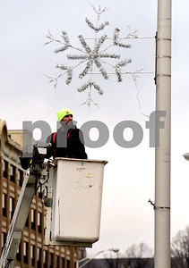1/4/2017 Mike Orazzi | Staff Bristol Parks & Recreation employee Todd Anderson removes decorations from North Main Street on Wednesday morning.