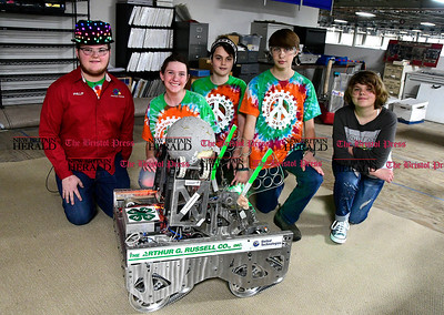 1/6/2017 Mike Orazzi | Staff Members of the Operation Peacce Robotics team, left to right, Phillip Weingart, Carol Pelizzari, Spencer Gallo, Will Laurie an Zoe Fisk with their creation Robo Rabbit inside the Arthur G. Russell Company on Clark Avenue in Bristol Friday.