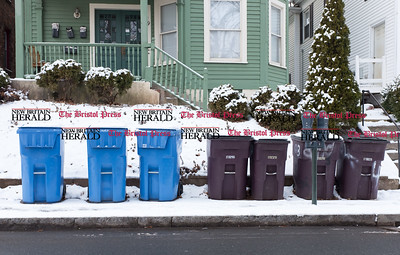 010616  Wesley Bunnell | Staff  Recycle and trash cans on the curb outside a home near downtown New Britain.