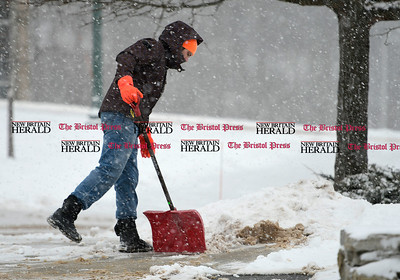 1/7/2017 Mike Orazzi | Staff Dylan Stanco shovels snow at CCSU in New Britain during Saturday's snow storm.