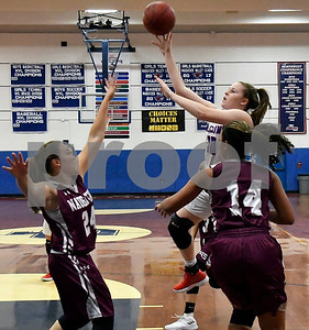 1/3/2017 Mike Orazzi | Staff St. Paul's Molly Hooks (10) during Wednesday night's girls basketball game with Naugatuck in Bristol.