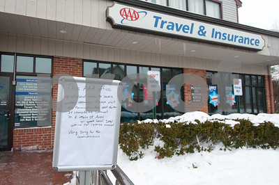 01/08/18  Wesley Bunnell | Staff  A sign informs visitors that a burst pipe overnight caused the AAA in Plainville to shut down and relocate workers to other locations while the damage is repaired.