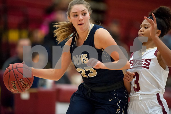 e01/08/18 Wesley Bunnell | Staff New Britain basketball was defeated by Newington on Monday evening at New Britain High School. Maya Gajowiak (23).