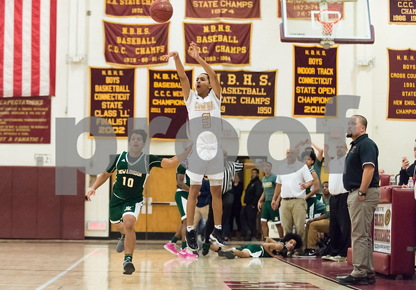 01/15/18 Wesley Bunnell | Staff New Britain High School boys basketball was defeated 53-52 by New London on Monday evening. Isaiah Jenkins (3) with a last second jump shot as coach Kurt Reis watches from the sideline.