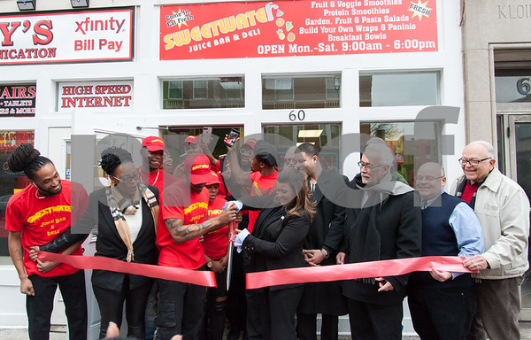 01/16/18 Wesley Bunnell | Staff The official ribbon cutting for Sweetwater Juice Bar & Deli located at 60 West Main St. was held on Tuesday afternoon. Mia Schand, 2nd from L, owner Mark Schand, Mayor Erin Stewart, Alderman Kristian Rosado, Alderman Daniel Salerno, Downtown District Director Jerry Amodio and Alderman Don Naples.