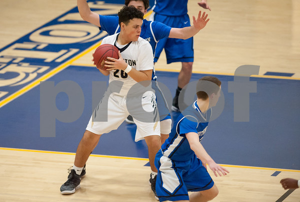 01/16/18 Wesley Bunnell | Staff Newington High boys basketball was defeated at home by Soutington on Tuesday evening 52-44. Julian Ortiz (20).