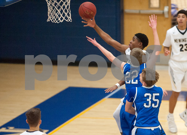 01/16/18 Wesley Bunnell | Staff Newington High boys basketball was defeated at home by Soutington on Tuesday evening 52-44. James Holley (2).