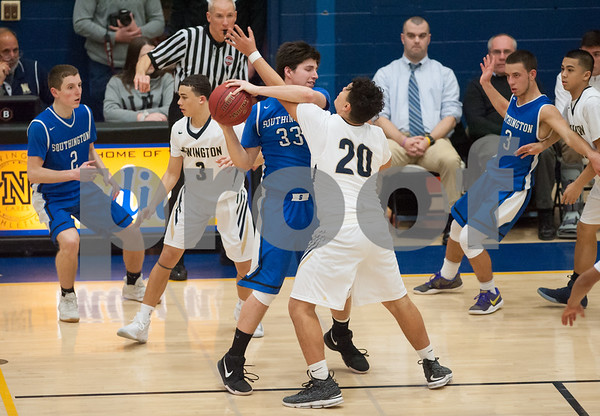 01/16/18 Wesley Bunnell | Staff Newington High boys basketball was defeated at home by Soutington on Tuesday evening 52-44. Jeremy Mercier (33) is fouled in the last minute of the game by Julian Ortiz (20).