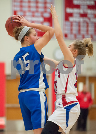 01/22/18 Wesley Bunnell | Staff Southington vs Berlin girls basketball at Berlin High School on Monday evening. Southington's Ali Carr (15) and Carly Grega (15) for Berlin.