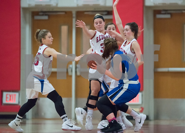01/22/18 Wesley Bunnell | Staff Southington vs Berlin girls basketball at Berlin High School on Monday evening. Janette Wadolowski (33) is guarded by 3 Berlin defenders after recovering a loose ball.